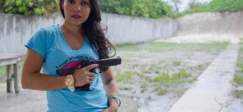 woman posing with hand gun