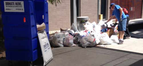 Photo of Goodwill staff inspecting waste during Ditch the Dumpster donation event