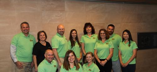 group of people in green polos