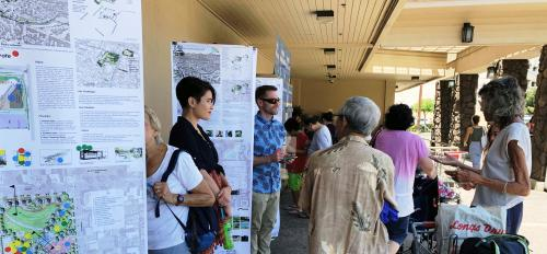 ASU students presenting park designs to community at neighborhood grocery store