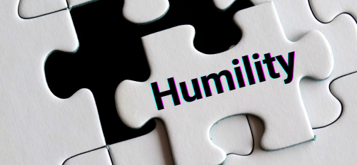 """Puzzle with final piece that has """"humility"""" on it"""