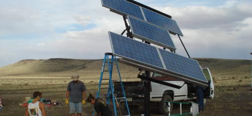 people installing solar panel