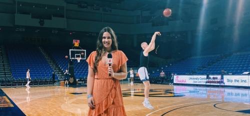 Woman reporting on basketball game
