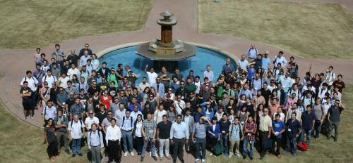photo of group of people in front of fountain