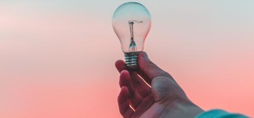 photo of hand holding lightbulb