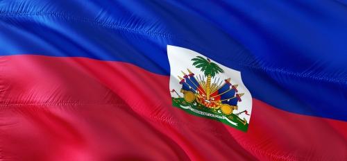 The Haitian flag behind a blue sky