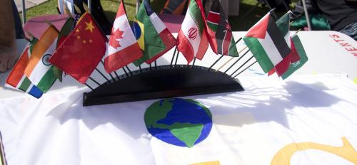 flags from different countries displayed on table