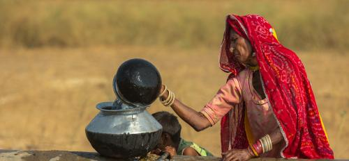 Indian woman gets water from well