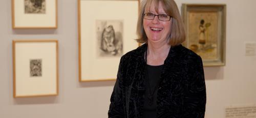 ASU Art Museum Curator of Prints Jean Makin poses in a gallery