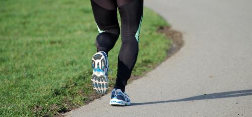 A man's legs shown jogging