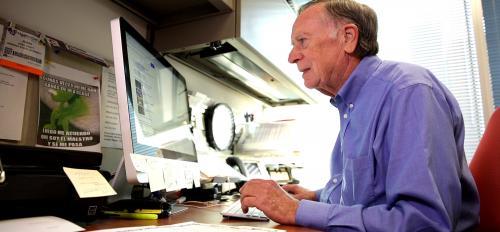 Man at a computer desk.
