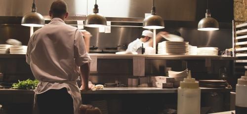 A crew works in a restaurant kitchen