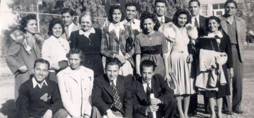 An antique photo of a group of Hispanic people