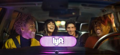 People ride in a Lyft car