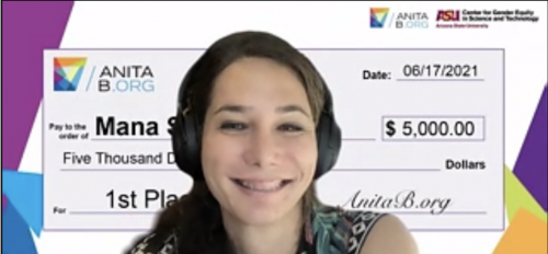 screen cap of Kalani Bright wearing headphones and smiling during a Zoom call in which she accepted the first place prize for Mana Studies in the AnitaB.org Pitch Competition