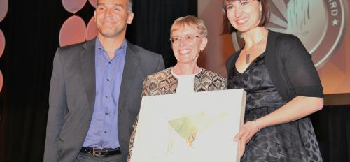 Marg Schmidt (center) receives her Governor's Arts Award from Rossitza Todorova,