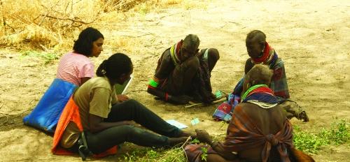 Sarah Mathew in the field with Turkana people