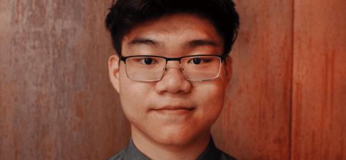 Headshot of the featured graduate, Michael Wang