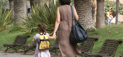 mother walking with child