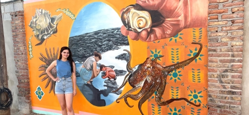 ASU student Jessica Potter with her tidal pool mural in Mexico