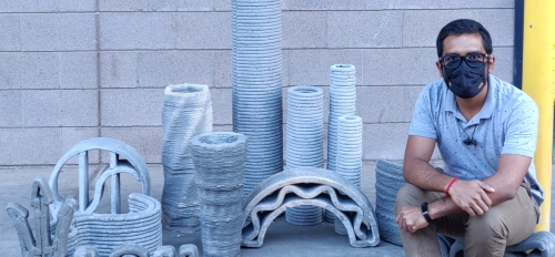Examples of 3D concrete printing shown with Sooraj Nair, an ASU doctoral student in Narayanan Neithalath's lab group