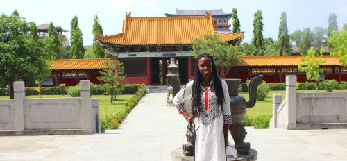 ASU PhD student Leah Jones stands outside Nepali temple