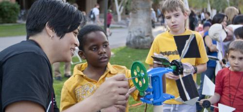 ASU scientist talks with Night of the Open Door visitor about wind energy