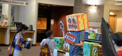 A child wears Minecraft costume pieces.