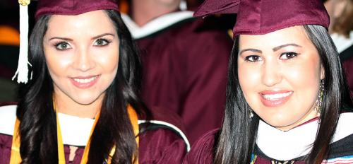 Ana Perez and Mariela Diaz received their graduate degrees in December 2014
