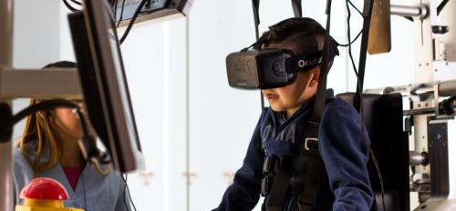 boy wearing a virtual reality mask