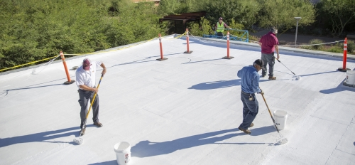 ASU employees apply coating to roof of Polytechnic campus building