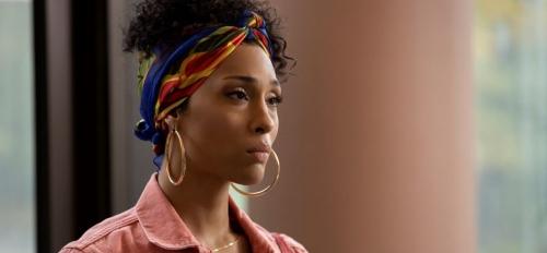 Trans person wearing earrings
