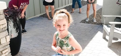 An ASU Prep Poly preschool student socially distant from her teachers