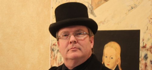 """Graduating ASU student Robert Lively poses for an era-appropriate photo before attending a December 2019 """"Victorian Christmas"""" event. He joked that his """"severe"""" expression was """"in keeping with Victorian traditions."""""""