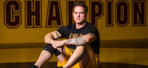 Wrestler sitting on a mat