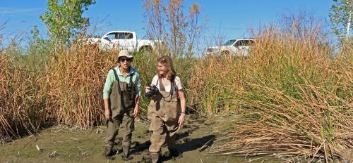 Sally Wittlinger and Lindsey Rustad stand in mud at Tres Rios, Arizona