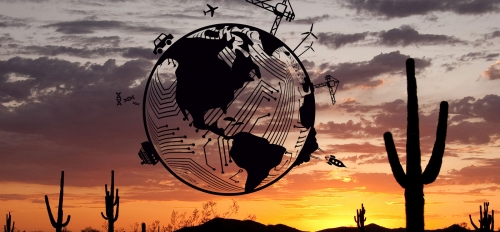 An illustrated globe with depictions of engineering disciplines superimposed on a desert sunset photo.