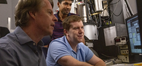rofessor Peter Crozier and students in electron microscopy center