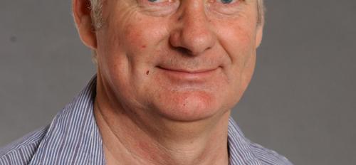 portrait of ASU professor John Spence