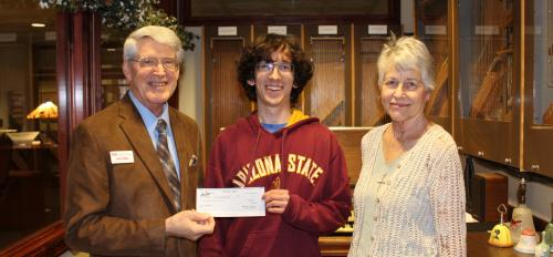 new student carillonneur Andrew Boyle posing with award