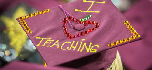 "graduation cap with ""I <3 teaching"" on it."