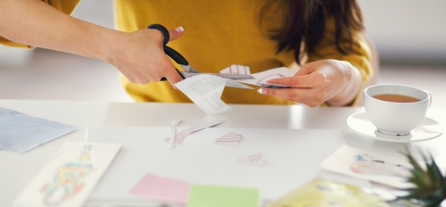 woman cutting paper