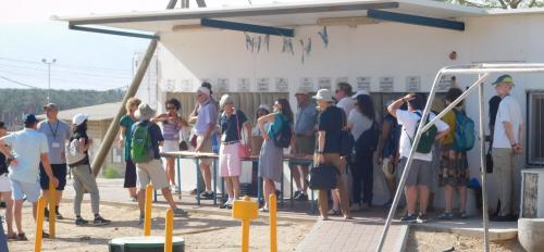group of people touring a kibbutz