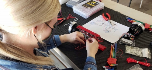 ASU robotics team Project Manager Andrea Schoonover assembling the pneumatics hull.