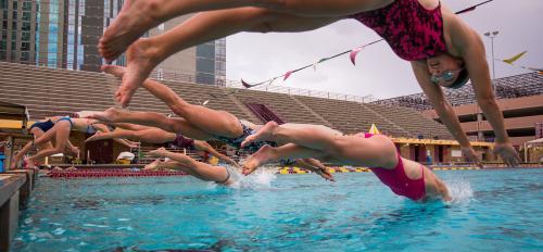 women's triathlon team dives in the pool