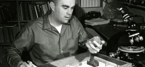 man holding meteorite
