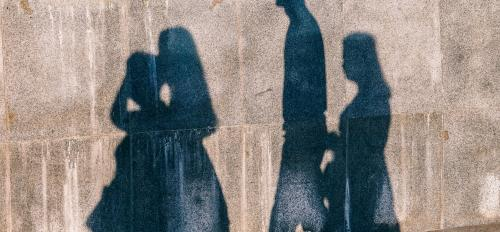 photo of people's shadows on wall