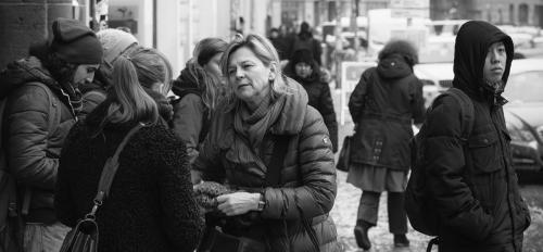 women talking on city street - Photo by Sascha Kohlmann