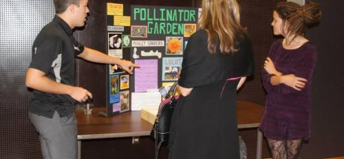 Students make a presentation about a pollinator garden.