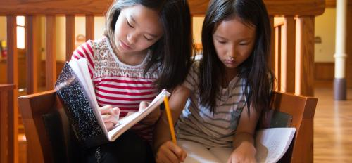 """Students in ASU English's youth writing program engage in a """"writing marathon"""" during a 2015 session."""